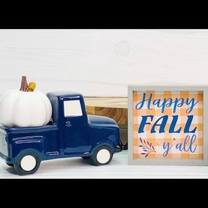 Farmhouse happy fall sign and pickup truck